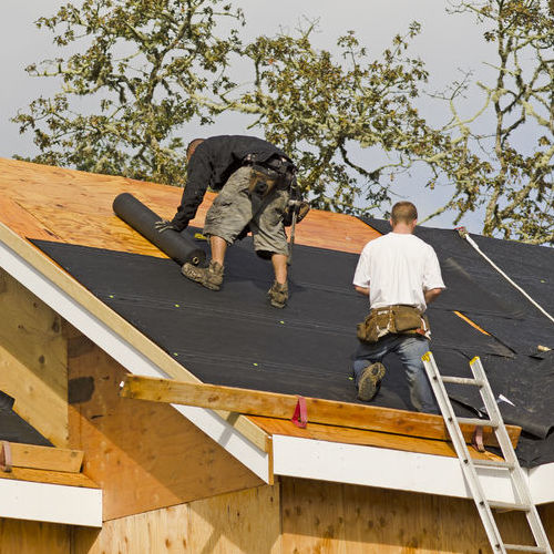 Roofers Add Sheathing to Roof.