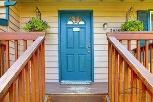 Stained Cedar Railing and Blue Door